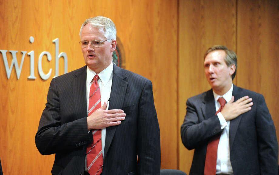 Superintendent of Schools, William McKersie, left, and Greenwich Board of Education member, Peter Sherr, say the Pledge of Allegiance during the board's meeting at Greenwich Town Hall, Thursday night, Aug. 30, 2012. Photo: Bob Luckey / Greenwich Time