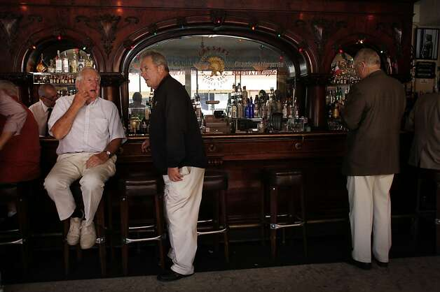 Bill Cancilla (left) and Herb Farber (second from left), both of Marin County, talk at the bar as they wait with friends to attend a group luncheon at Caesar's Italian Restaurant  on Thursday, August 30, 2012 in San Francisco, Calif. Photo: Lea Suzuki, The Chronicle