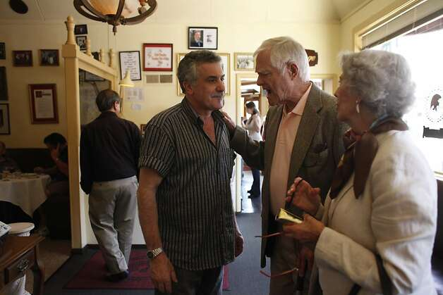 Co-owner Matteo Crivello(l to r) talks with Bob Logan and Diana Logan, both of San Mateo as the Logan's arrive to have a last meal at Caesar's Italian Restaurant  before it's closure on Thursday, August 30, 2012 in San Francisco, Calif. Logan said he cried when he heard the news of Caesar's Italian Restaurant's closing. Photo: Lea Suzuki, The Chronicle