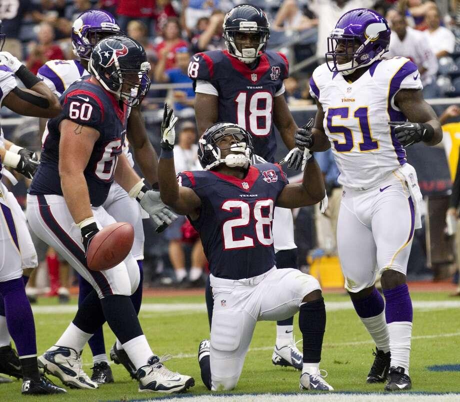 Justin Forsett celebrates his 3-yard touchdown run. (Brett Coomer / © 2012  Houston Chronicle)