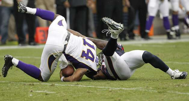 Vikings quarterback Joe Webb was sacked by Texans linebacker Tim Dobbins during the first quarter. (Cody Duty / © 2011 Houston Chronicle)