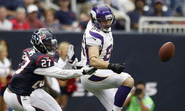 Texans defensive back Quintin Demps breaks up a pass intended for Vikings tight end Mickey Shuler. (Brett Coomer / © 2012  Houston Chronicle)