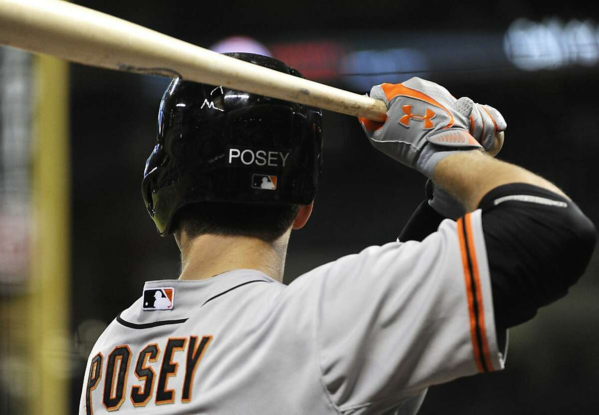 San Francisco Giants' Buster Posey prepares for an at bat in a baseball game against the Houston Astros Wednesday, Aug. 29, 2012, in Houston. (AP Photo/Pat Sullivan)