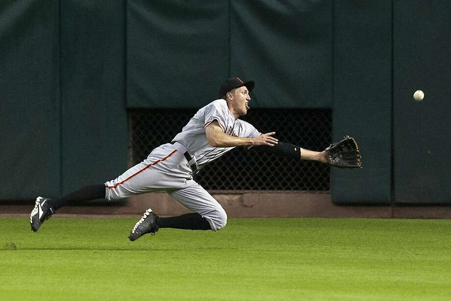 San Francisco Giants right fielder Hunter Pence (8) dives for a ball hit by Houston Astros' Matt Dominguez (30) for a triple during the second inning of a baseball game, Thursday, Aug. 30, 2012, in Houston.  Photo: Patric Schneider, Associated Press