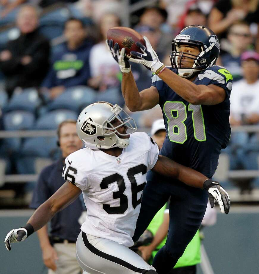 Seattle Seahawks' Golden Tate (81) catches the ball in front of Oakland Raiders' Shawntae Spencer in the first half. Photo: AP