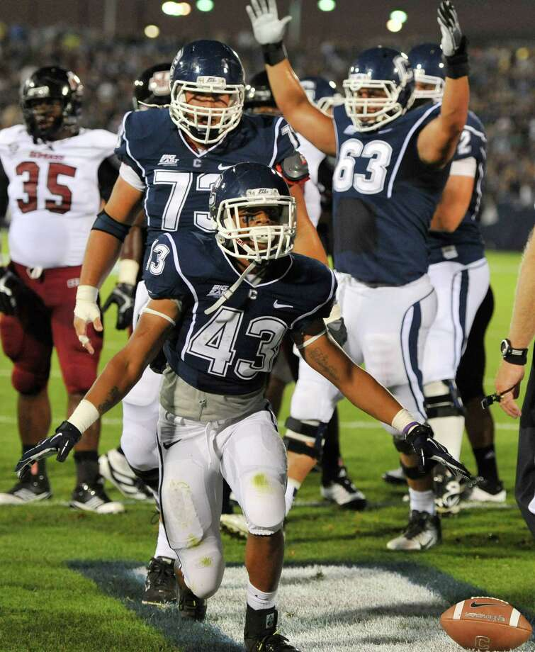 Connecticut's Lyle McCombs (43) celebrates his touchdown against Massachusetts in the first half of an NCAA college football game in East Hartford, Conn., Thursday, Aug. 30, 2012. (AP Photo/Jessica Hill) Photo: Jessica Hill, Associated Press / FR125654 AP