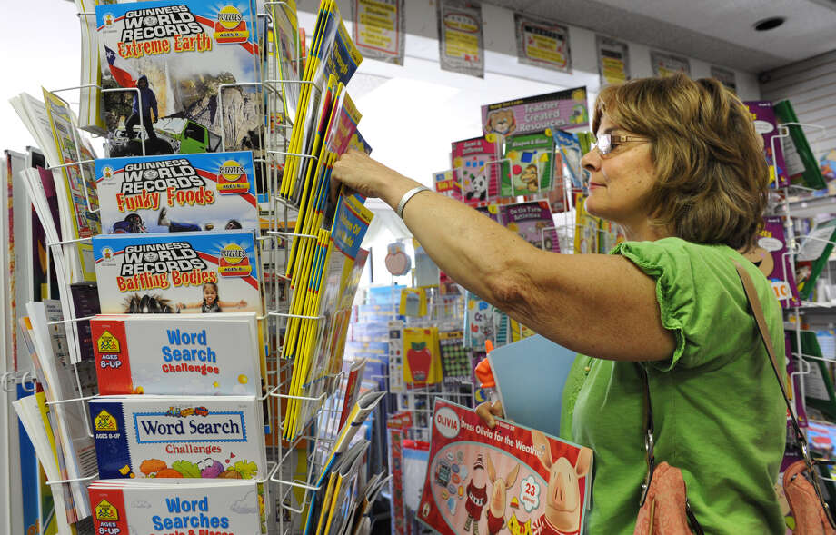 Sue Fuller, a teacher at Our Lady of Victory Childhood Center, shops for books at The Parent and Teacher Store on Thursday, Aug. 30, 2012 in Latham, N.Y. (Lori Van Buren / Times Union) Photo: Lori Van Buren
