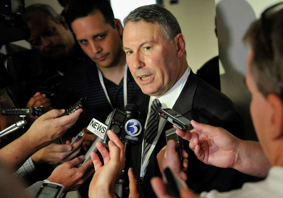 Big East commissioner Mike Aresco answers questions from the media before an NCAA college football game between Connecticut and Massachusetts at Rentschler Field in East Hartford, Conn., Thursday, Aug. 30, 2012. (AP Photo/Jessica Hill) Photo: Jessica Hill, Associated Press / FR125654 AP