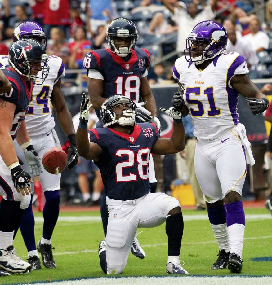 Houston Texans running back Justin Forsett (28) celebrates his 3-yard touchdown run against the Minnesota Vikings during the first quarter of an NFL pre-season football game at Reliant Stadium on Thursday, Aug. 30, 2012, in Houston. Photo: Brett Coomer, Houston Chronicle / © 2012  Houston Chronicle