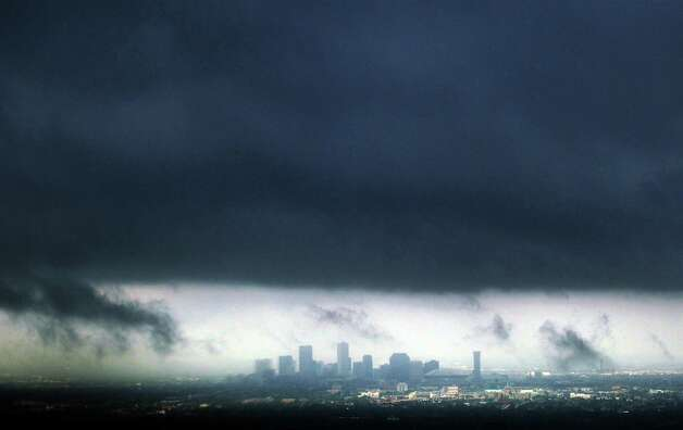 The city of New Orleans lies under a heavy band of storms in the aftermath of  Isaac on Thursday, Aug. 30, 2012. Isaac hovered over Louisiana for a third day Thursday, shedding more than a foot of additional rain that forced authorities to hurriedly evacuate areas ahead of the storm and rescue hundreds of people who could not escape as the rapidly rising waters swallowed entire neighborhoods. Photo: Michael Democker, Associated Press / The Times-Picayune