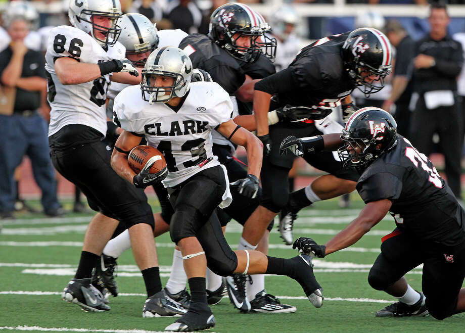 Branden Valle blows up the middle for the Cougars as Churchill hosts Clark in the Gucci Bowl at Comalander Stadiumon August 30, 2012. Photo: Tom Reel, Express-News / ©2012 San Antono Express-News