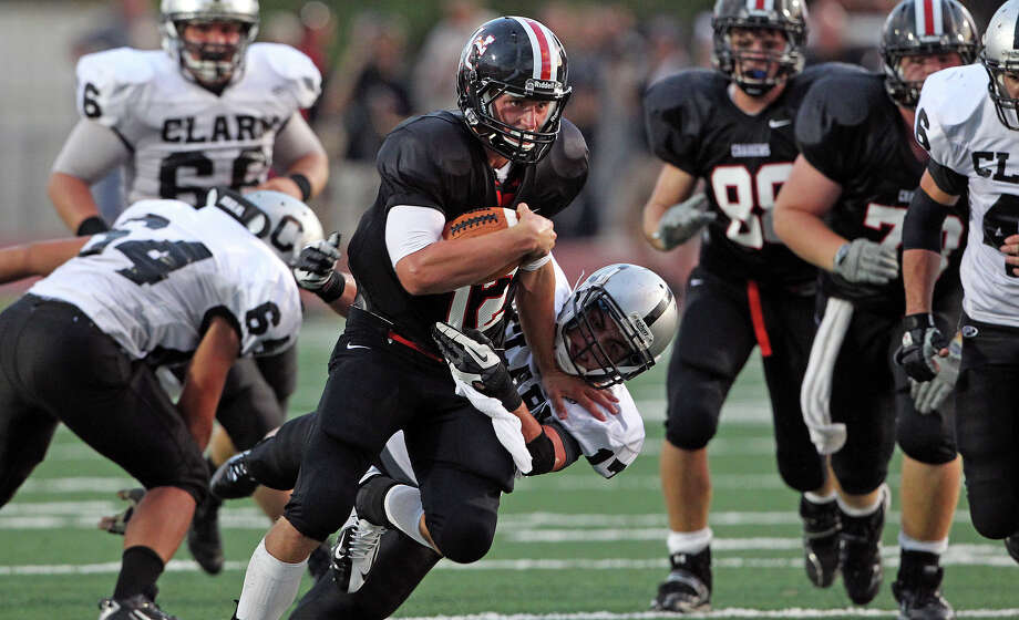 Charger quarterback Nate Pearson finds a hole in the middle as Churchill hosts Clark in the Gucci Bowl at Comalander Stadiumon August 30, 2012. Photo: Tom Reel, Express-News / ©2012 San Antono Express-News