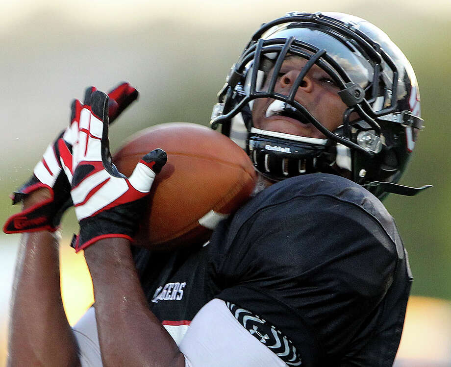 Dimitri Flowers cradles a long touchdown pass for the Chargers as Churchill hosts Clark in the Gucci Bowl at Comalander Stadiumon August 30, 2012. Photo: Tom Reel, Express-News / ©2012 San Antono Express-News