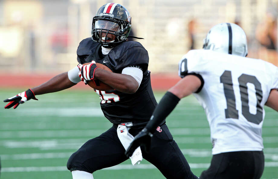 The Charger's Dimitri Flowers breaks for an opening on the outside to score a first quarter touchdwon as Churchill hosts Clark in the Gucci Bowl at Comalander Stadiumon August 30, 2012. Photo: Tom Reel, Express-News / ©2012 San Antono Express-News