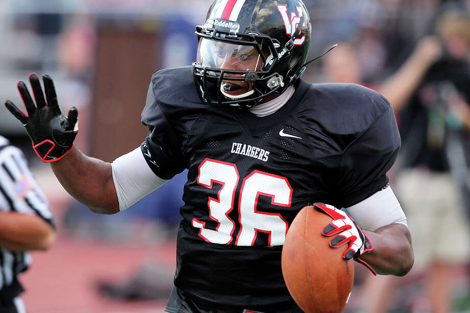 The Charger's Dimitri Flowers tip toes in for a first quarter touchdown as Churchill hosts Clark in the Gucci Bowl at Comalander Stadiumon August 30, 2012. Photo: Tom Reel, Express-News / ©2012 San Antono Express-News