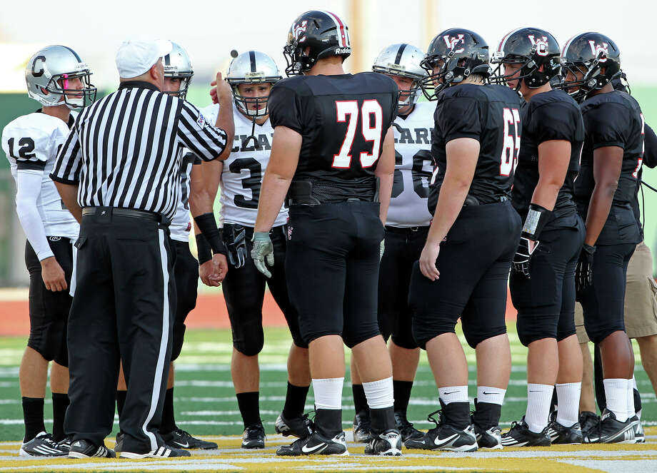 The referee does the coin toss as Churchill hosts Clark in the Gucci Bowl at Comalander Stadiumon August 30, 2012. Photo: Tom Reel, Express-News / ©2012 San Antono Express-News