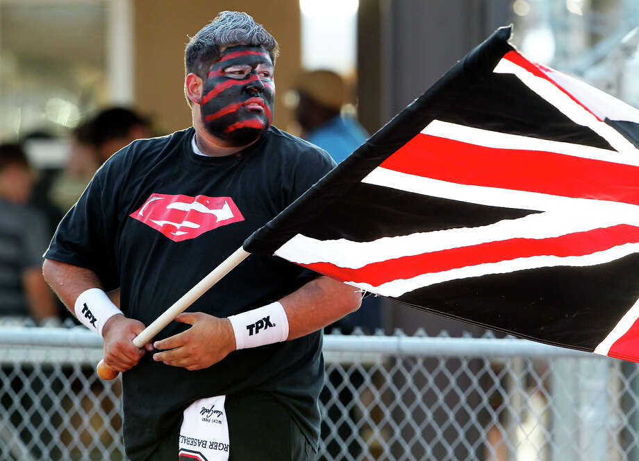 Superfan Nick Rodriguez gets ready to carry the Charger flag as Churchill hosts Clark in the Gucci Bowl at Comalander Stadiumon August 30, 2012. Photo: Tom Reel, Express-News / ©2012 San Antono Express-News