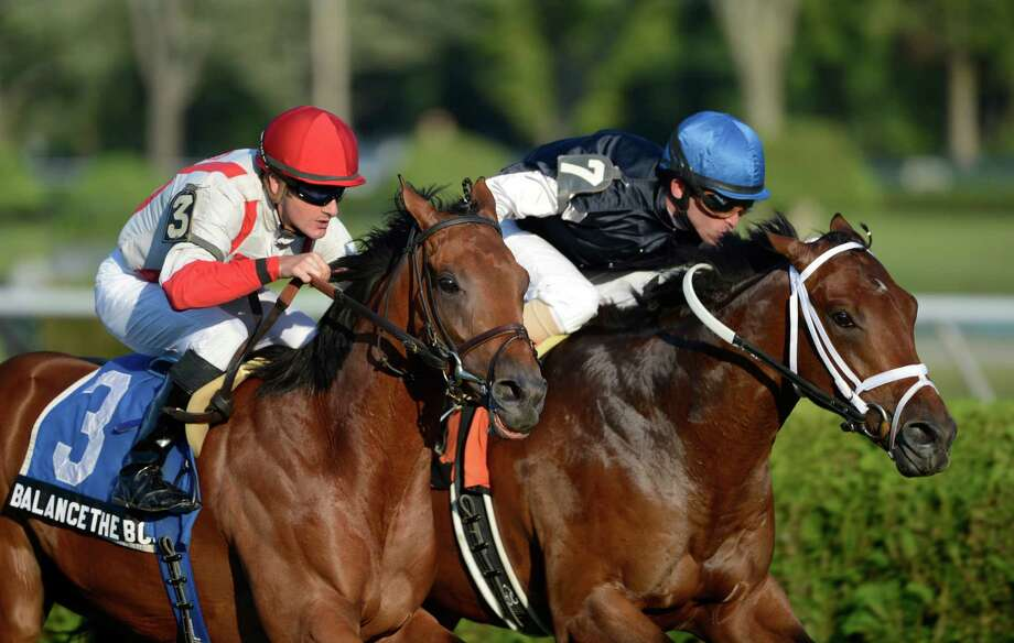 Balance the Books ridden by Julien Leparoux comes up on the outside to beat Joha with Ramon Dominguez in the irons to the wire in the 8th running of The With Anticipation at the Saratoga Race Course in Saratoga Springs, N.Y. Aug. 30, 2012.  (Skip Dickstein/Times Union) Photo: Skip Dickstein