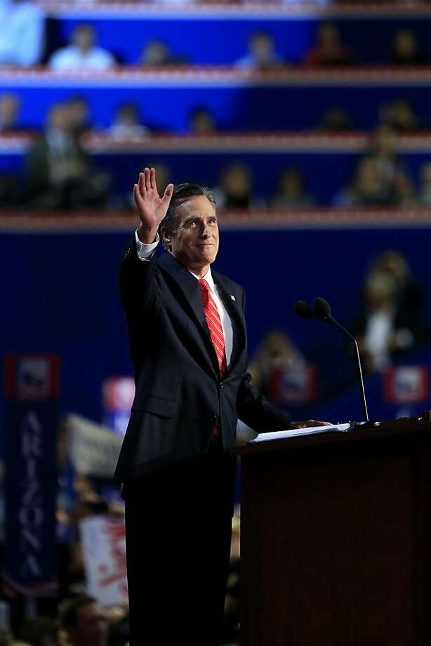 Republican presidential candidate Mitt Romney greets the delegates as he takes the stage to accept the nomination. Photo: Andrew Harrer, Bloomberg