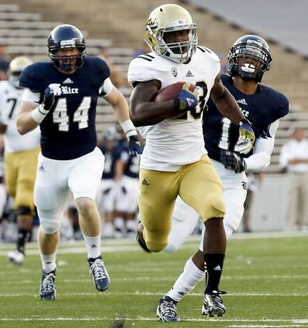 UCLA's Johnathan Franklin ran for 214 yards and three touchdowns. Photo: Eric Kayne, Associated Press