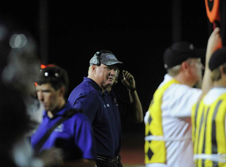 Warren football coach Bryan Dausin watches his team in action against MacArthur at Heroes Stadium on Thursday, Aug. 30, 2012. Photo: Billy Calzada, Express-News / © San Antonio Express-News