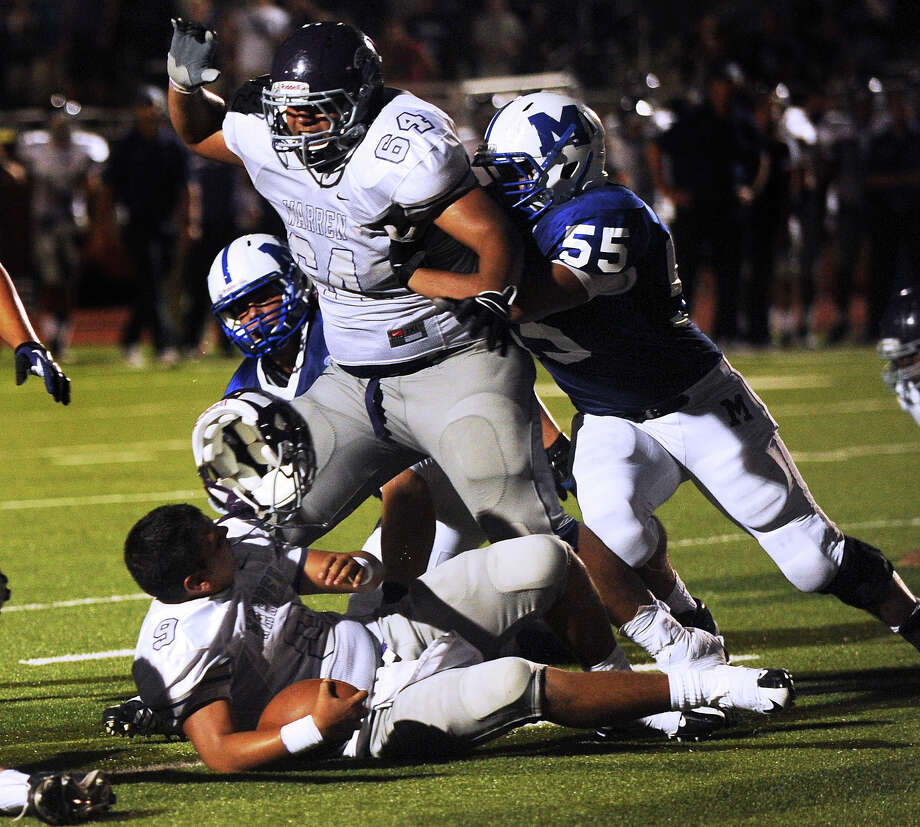 Warren quarterback Ryan Larson loses his helmet as he scores a touchdown during high-school football action against MacArthur at Heroes Stadium on Thursday, Aug. 30, 2012. Photo: Billy Calzada, Express-News / © San Antonio Express-News