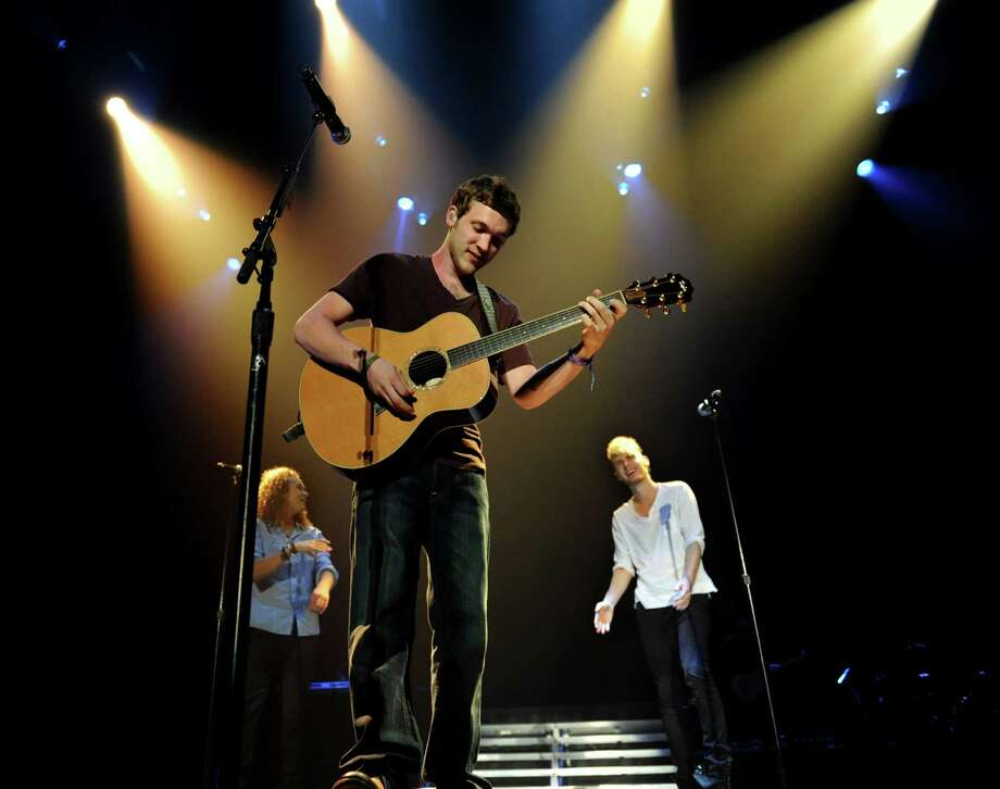 "Phillip Phillips, center, performs with Heejun Han, left, and Colton Dixon during the ""American Idol Live Tour 2012"" on Thursday, Aug. 30, 2012, at Times Union Center in Albany, N.Y. (Cindy Schultz / Times Union) Photo: Cindy Schultz / 00018952A"