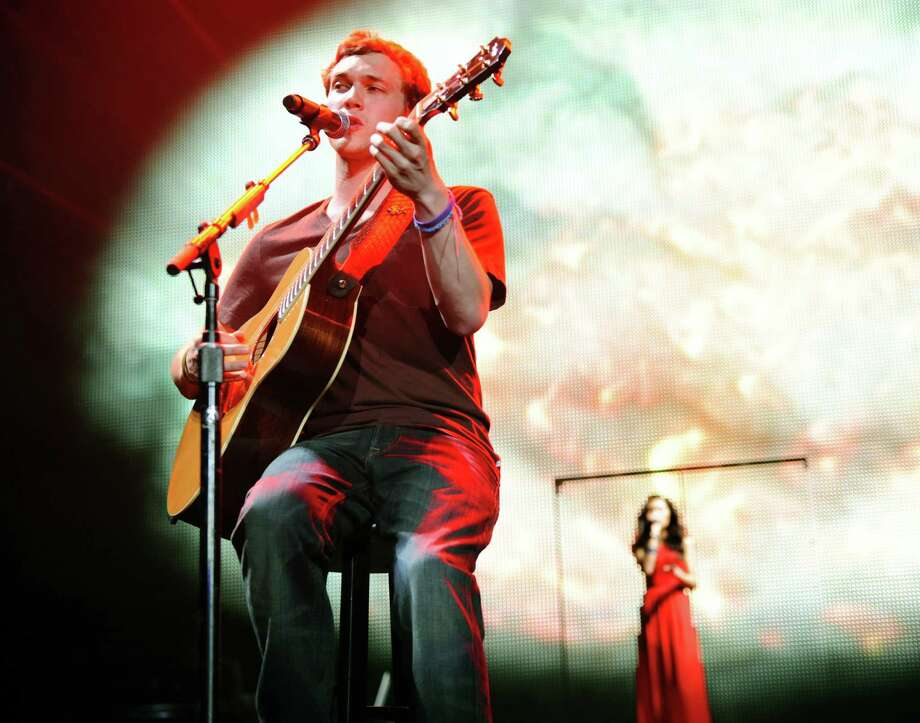 "Phillip Phillips, left, performs as Jessica Sanchez sings backup during the ""American Idol Live Tour 2012"" on Thursday, Aug. 30, 2012, at Times Union Center in Albany, N.Y. (Cindy Schultz / Times Union) Photo: Cindy Schultz / 00018952A"