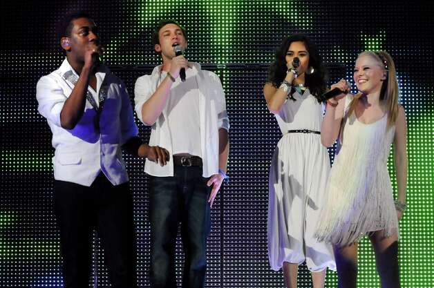 "Joshua Ledet, left, Phillip Phillips, center, Jessica Sanchez, second from right, and Hollie Cavanagh perform during the ""American Idol Live Tour 2012"" on Thursday, Aug. 30, 2012, at Times Union Center in Albany, N.Y. (Cindy Schultz / Times Union) Photo: Cindy Schultz / 00018952A"