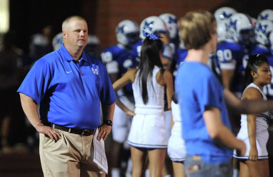 MacArthur football coach Ben Cook prepares for the second-half of action against Warren at Heroes Stadium on Thursday, Aug. 30, 2012. Photo: Billy Calzada, Express-News / © San Antonio Express-News