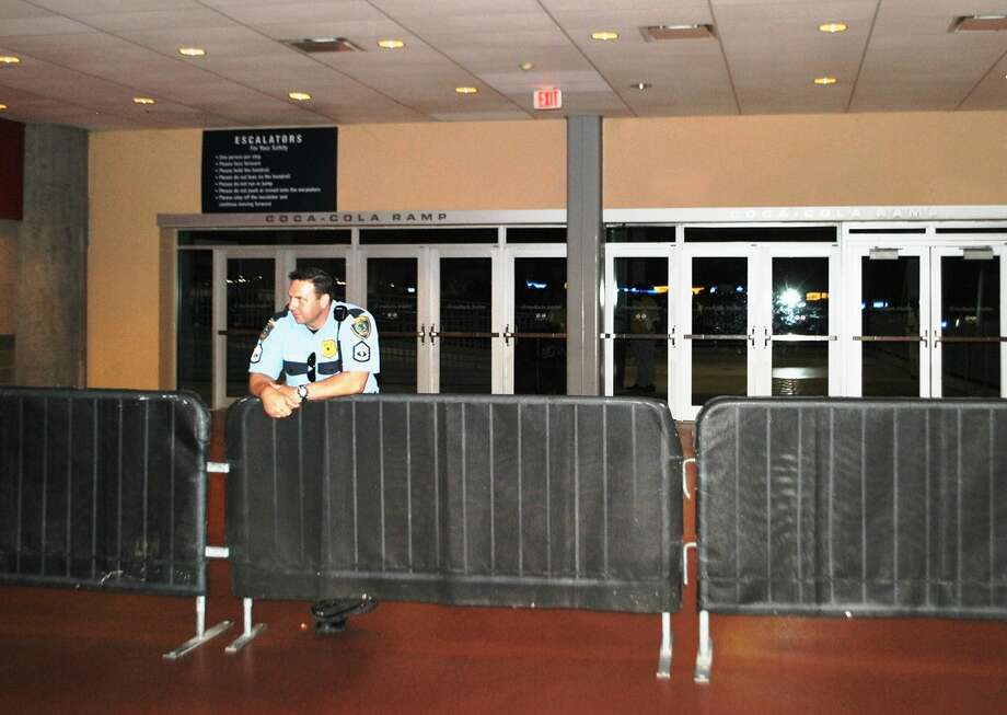 Police block the exit to the escalator where a fan fell to his death at Reliant Stadium. (Anna-Megan Raley / Courtesy of CBS Houston)