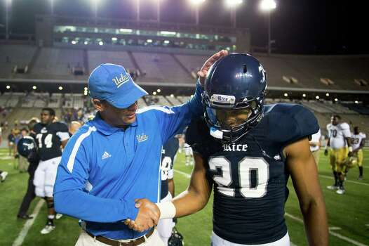 Rice safety Corey Frazier gets a pat on the helmet from UCLA head coach Jim Mora after the Bruins victory at Rice Stadium. Frazier is the son of Minnesota Vikings head coach Leslie Frazier. UCLA won the game 49-24. Photo: Smiley N. Pool, Houston Chronicle / © 2012  Houston Chronicle