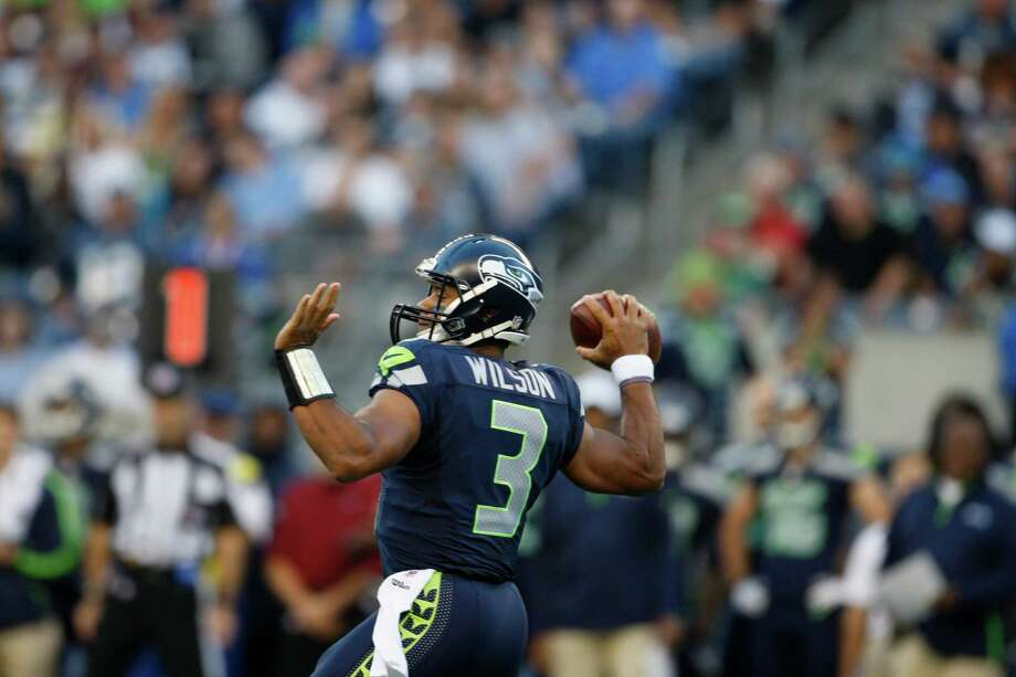 Seattle Seahawks Russell Wilson with the ball during the first half. Photo: AP