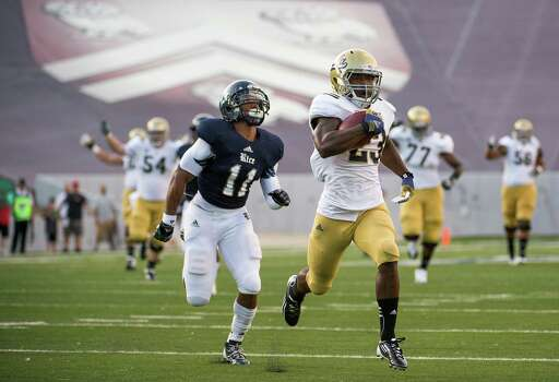 UCLA 49, Rice 24UCLA running back Johnathan Franklin (23) scores on a 74-yard touchdown run past Rice Owls safety Malcolm Hill (11). Photo: Smiley N. Pool, Houston Chronicle / © 2012  Houston Chronicle
