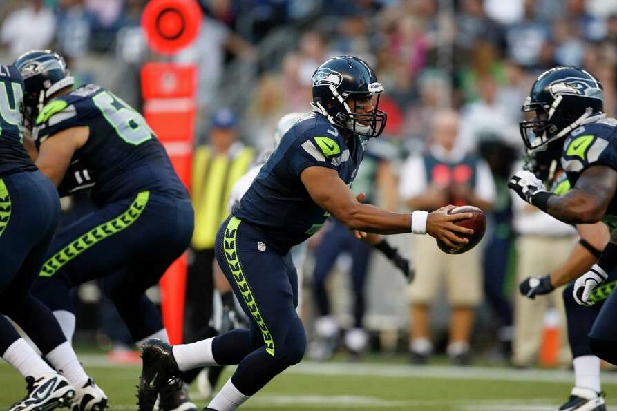 Seattle Seahawks Russell Wilson with the ball during the first half.