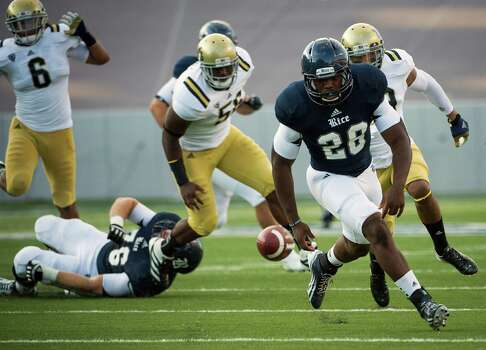 Rice running back Charles Ross (28) chases a fumble during the first quarter against UCLA. Photo: Smiley N. Pool, Houston Chronicle / © 2012  Houston Chronicle