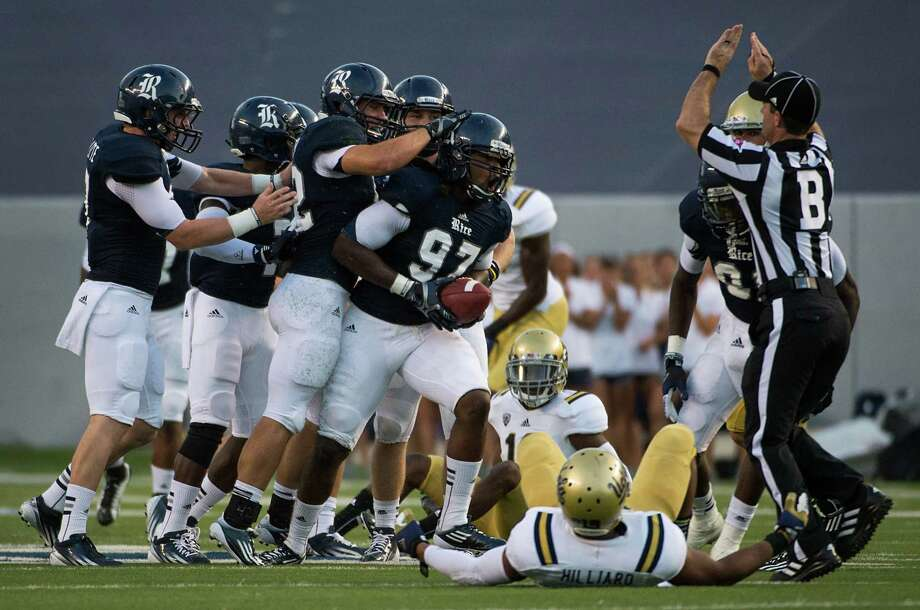 Rice's Jared Williams (97) celebrates after recovering a muffed UCLA punt return during the first half. Photo: Smiley N. Pool, Houston Chronicle / © 2012  Houston Chronicle