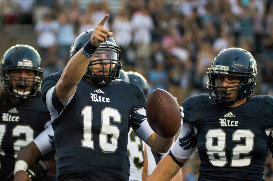 Rice Owls quarterback Taylor McHargue (16) celebrates after scoring a touchdown during the first half. Photo: Smiley N. Pool, Houston Chronicle / © 2012  Houston Chronicle
