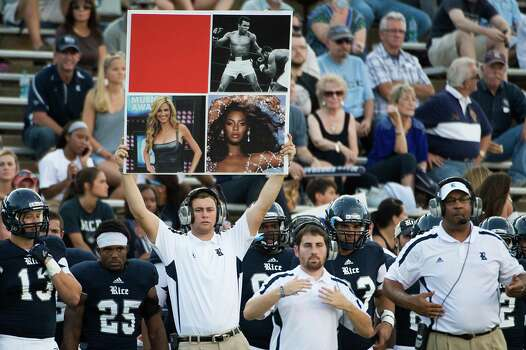 Rice Owls assistant coaches call in a play against the UCLA Bruins. Photo: Smiley N. Pool, Houston Chronicle / © 2012  Houston Chronicle