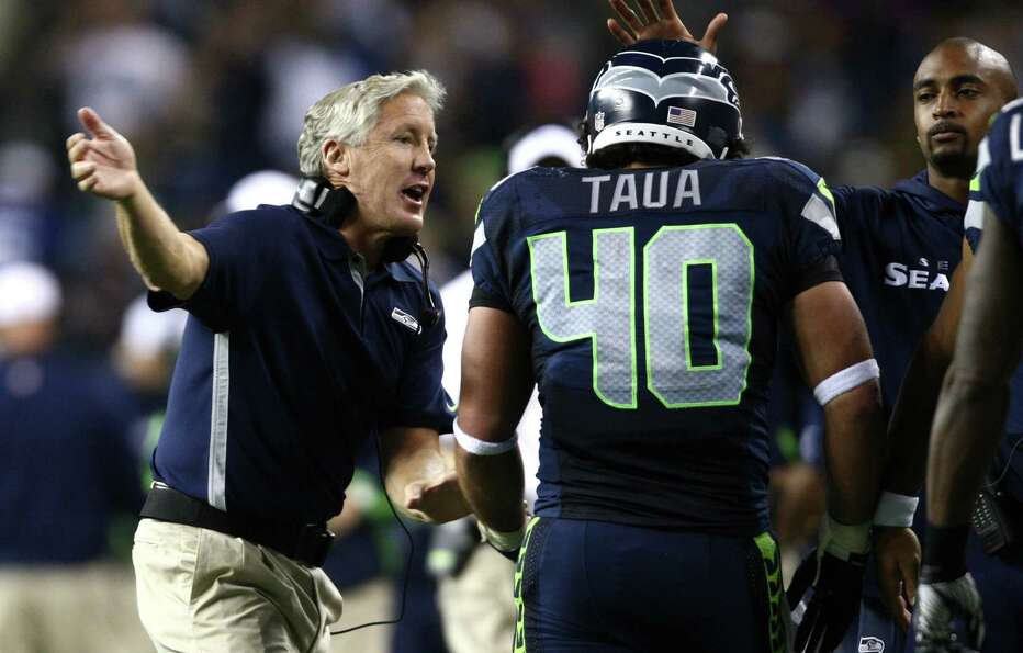 Seattle Seahawks coach Pete Carroll congratulates Vai Taua after a two yard run for a touchdown in t