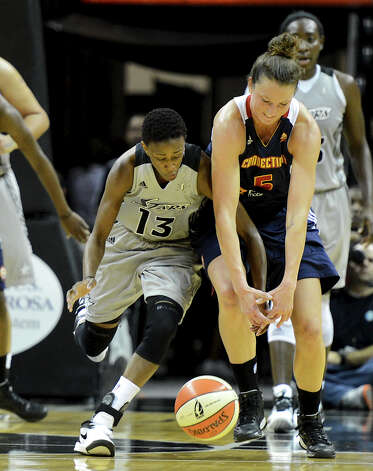 San Antonio Silver Stars' Danielle Robinson (13) battles Connecticut Sun's Kelsey Griffin (5) for a loose ball during a WNBA game between the San Antonio Silver Stars and the Connecticut Sun on August 30, 2012 at the AT&T Center in San Antonio Texas. John Albright / Special to the Express-News. Photo: JOHN ALBRIGHT, Express-News / San Antonio Express-News