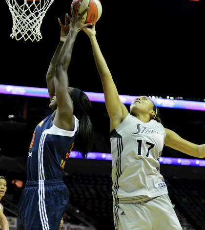 San Antonio Silver Stars' Ziomara Morrison (17) battles Connecticut Sun's Tina Charles (left) for a rebound during a WNBA game between the San Antonio Silver Stars and the Connecticut Sun on August 30, 2012 at the AT&T Center in San Antonio Texas. John Albright / Special to the Express-News. Photo: JOHN ALBRIGHT, Express-News / San Antonio Express-News