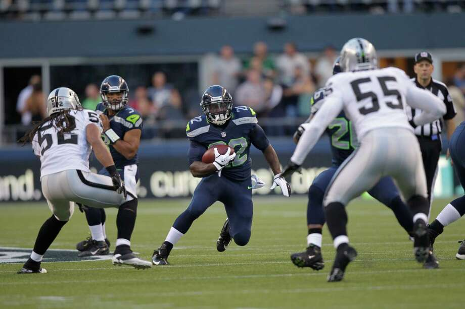 Seattle Seahawks Robert Turbin runs the ball against the Oakland Raiders in the first half. Photo: AP