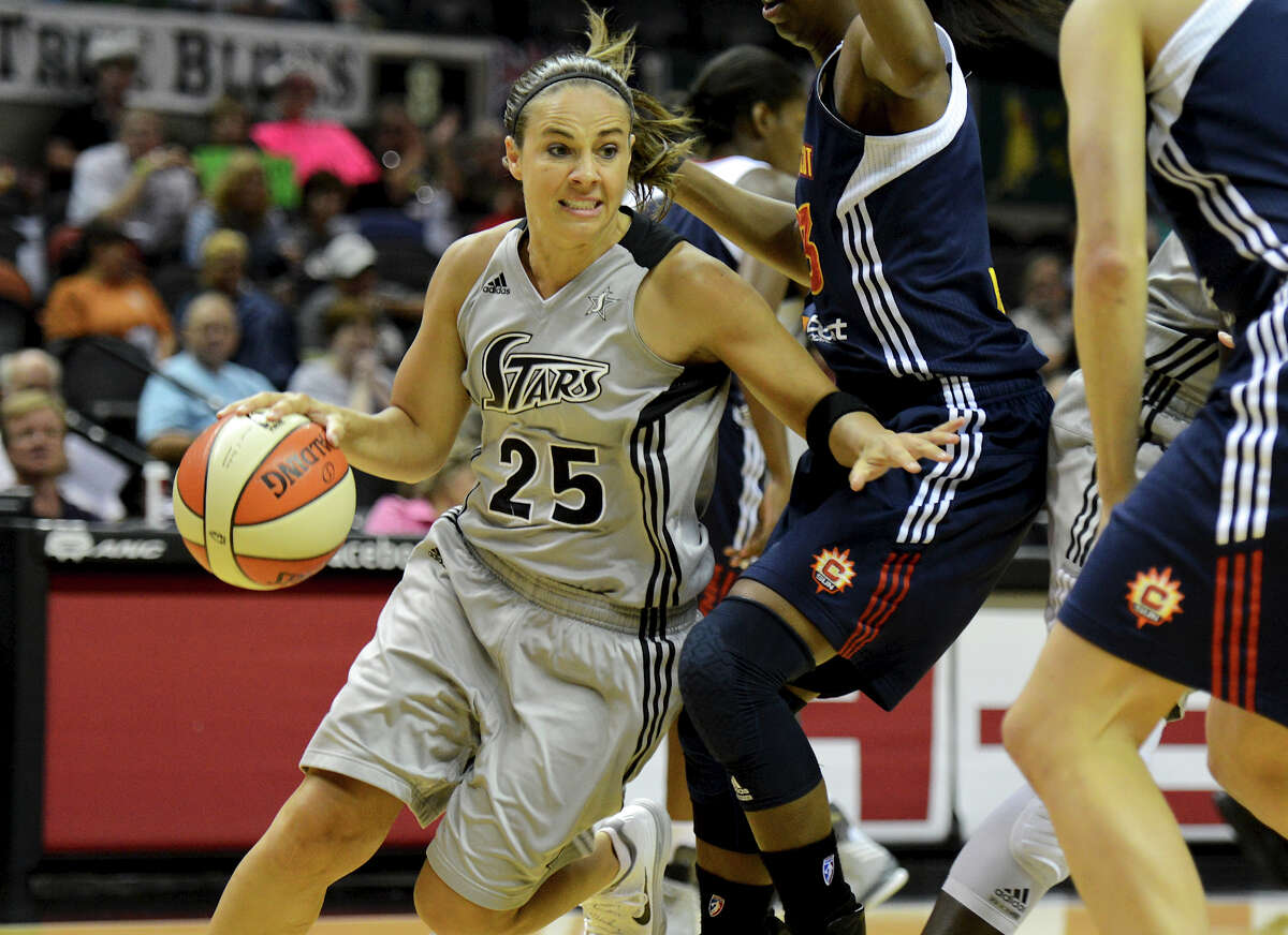 San Antonio Silver Stars' Becky Hammon (25) drives the ball around a defender during a WNBA game between the San Antonio Silver Stars and the Connecticut Sun on August 30, 2012 at the AT&T Center in San Antonio Texas. John Albright / Special to the Express-News.