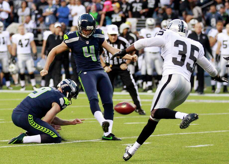 Seattle Seahawks' Steven Hauschka (4) kicks a 25-yard field goal as Jon Ryan holds and Oakland Raiders' Chimdi Chekwa moves in during the first half. Photo: AP