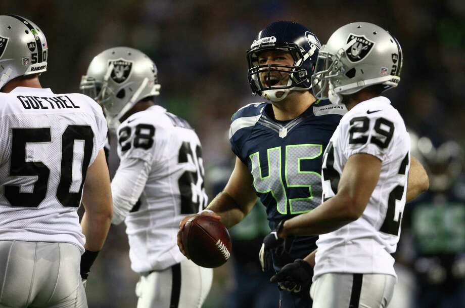 Seattle Seahawks player Sean McGrath lets out a roar after a play against the Oakland Raiders. Photo: JOSHUA TRUJILLO / SEATTLEPI.COM
