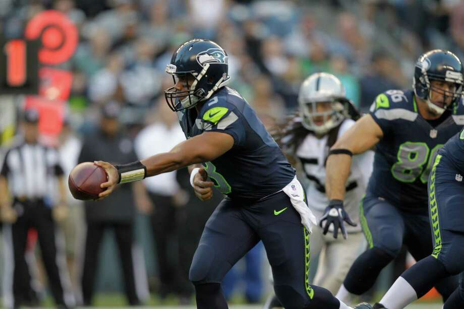 Seattle Seahawks Russell Wilson in action against the Oakland Raiders in the first half. Photo: AP