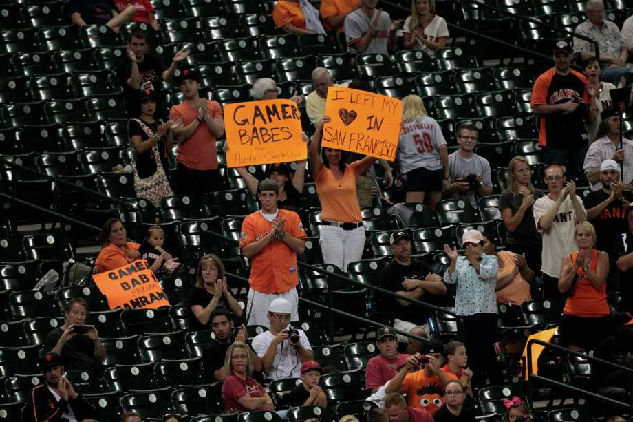 A group of Giants fans was among the 12,835 on hand to watch the Astros' 91st loss of the season Thursday night at Minute Maid Park. The crowd was the smallest in the history of the downtown ballpark. Photo: Billy Smith II / © 2012 Houston Chronicle