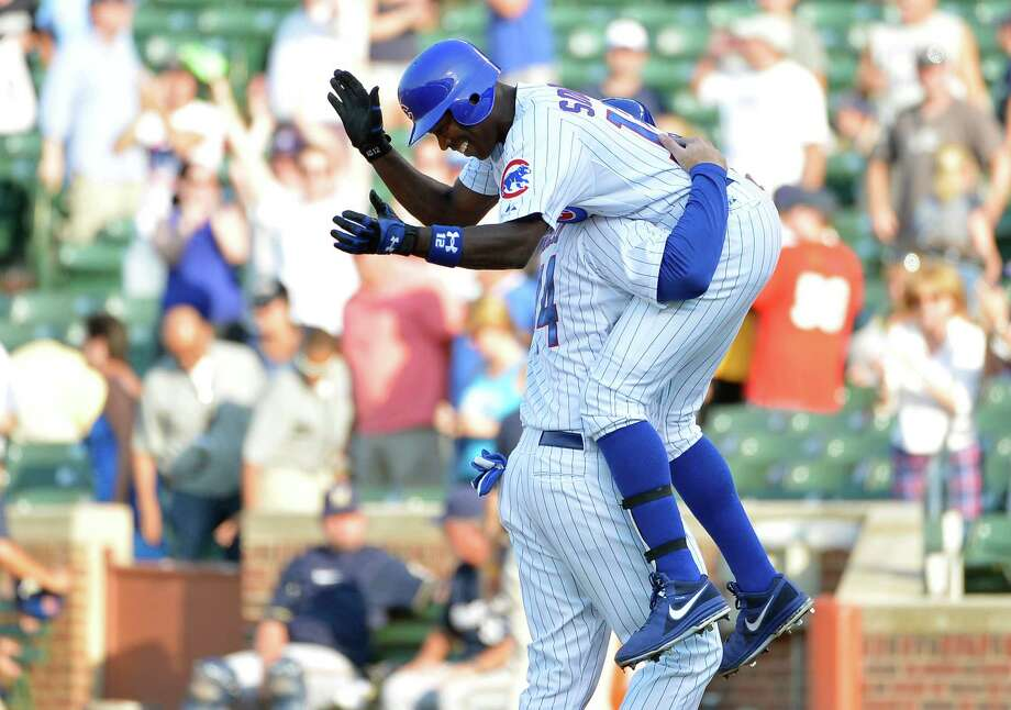 The Cubs' Alfonso Soriano got a well-deserved pick-me-up from teammate Anthony Rizzo after delivering a walk-off RBI single in the ninth inning. Photo: Brian Kersey / 2012 Getty Images