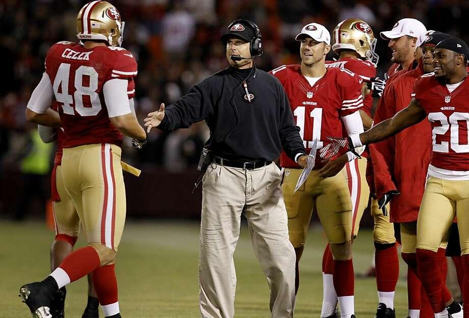 Coach Jim Harbaugh and quarterback Alex Smith are immune to criticism. Photo: Brant Ward, The Chronicle